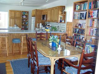 Deer Isle house photo - Large kitchen dining area seats 6-8 for fresh seafood meals.