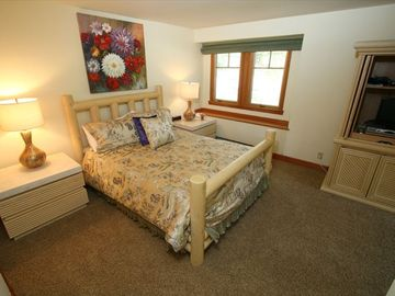 Luxurious Queen Master Bedroom with Flat Screen T.V.