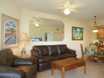 Comfortable living room to relax in. Dining room table for four.