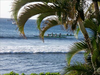 Watch Hawaiian canoes in front of the condo