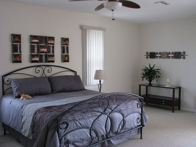 Huge Master Bedroom with King Size bed with sliding door overlooking the pool