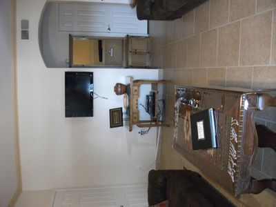 looking from patio into living room, flat screen tv with DVD player