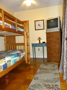 Twin bunk bed, TV w/ VCR&DVD player, 'Across from laundry room'