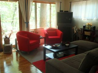 North Stonington house photo - Classy,colorful LR, w/comfy chairs and L-shape sofa,new curtains,large TV,DVD