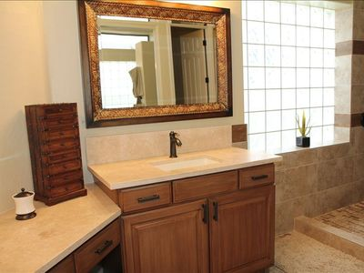Master Bath, 2 vanities, walk in shower, travertine slab counters