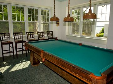 Game room with pool table and darts