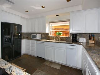 San Clemente house photo - Gormet kitchen with granite counters and quality appliances.