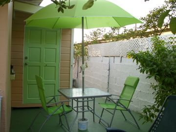 Studio entrance on lower level, Outdoor patio, with umbrella and chairs