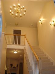 Laconia house photo - Elegant entryway with brass chandelier - upstairs
