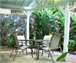 Private garden patio with covered dining area