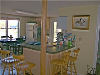 Great Island cottage photo - breakfast nook, open concept living