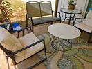 Back patio has conversation area and outdoor dining area.