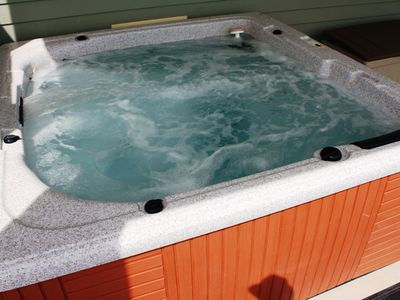 Soak your cares away in the 6-person hot tub