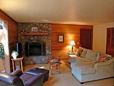"Living Room (alternate view)- River Rock, wood-burning fireplace & 42"" TV"