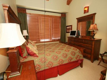 The Queen Bedroom has a beautiful view and a private bath with shower.