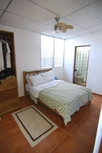 Typical bedroom with full size bed and private full bathroom. 4 equal bedrooms.