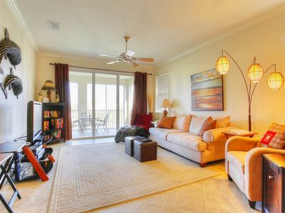 Our newly decorated living area and lanai - The cool tile floors and the warm butter walls of Tidelands Sunshine Condo create a cozy haven for lounging, eating, or sleeping in this spacious living area. The wide open space makes room for relaxing or entertaining.