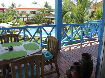 View from the kitchen window to breakfast table on balcony, overlooking the pool