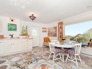 "Dining area with a mosaic floor called ""Stepping Stones through a Flower Garden."