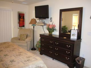 Cape Coral house photo - master: recliner and lamp, 32 inch tv,