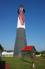 Tybee Island condo photo - Tybee Light house is a must see, the big flag is up for special occasions.