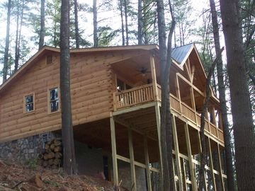 Cherry Log cabin rental - screened porch, view from the woods