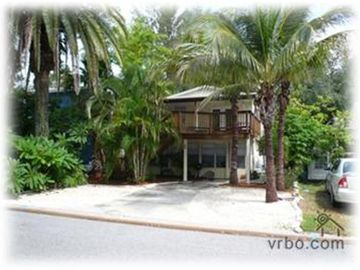 Sunset Beach studio rental - Front of house - studio is all of the downstairs of the home.