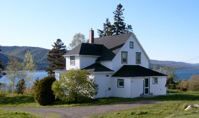 Lovingly restored Cape Breton farmhouse with panoramic views of St. Ann's Bay.