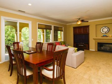 Irvine townhome rental - Open Spacious Living Area with Sectional, Dining table, and 58' Smart TV.