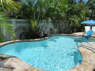 Brand new heated pool in your sunny private tropical backyard