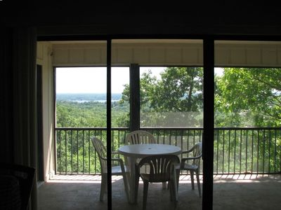 Screened in porch with view of the lake.