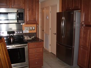 Folly Field condo photo - Hilton Head Island~Beautiful Kitchen Cabinets; mood lighting in the dining area.