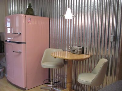 RETRO RETREAT - A BLAST FROM THE PAST - Back in time with this pink fridge and cafe seating