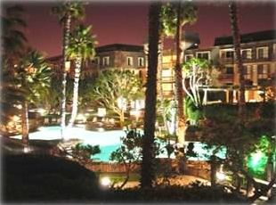 Night time view from our balcony of E104 of the pool and spa areas - beautiful!