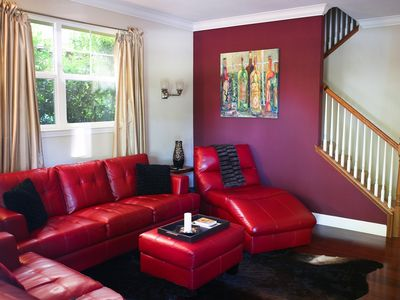 Red Leather couches and original art