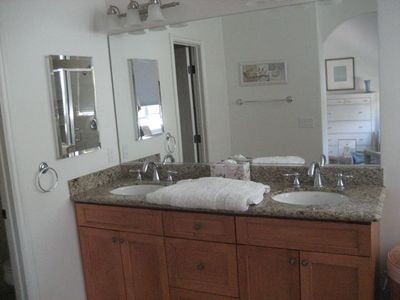Both full bath rooms have double sinks/ tub/shower/granite counter