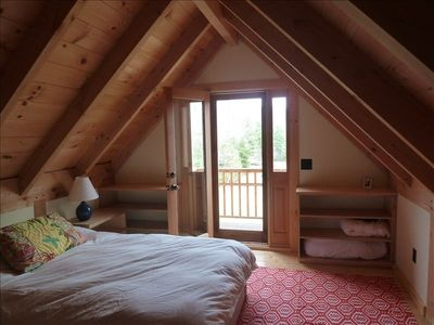 Upstairs loft with queen bed and private balcony