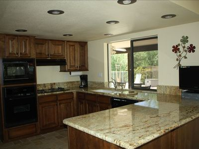 Large kitchen with granite counters
