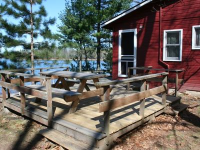 Large wrap-around deck with (2) picnic tables and log swing!