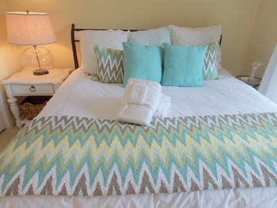 Freshly painted and newly designer furnished king downstairs bedroom...beachy!