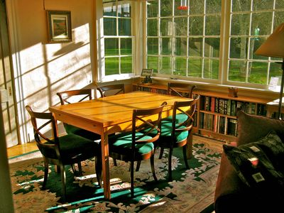 Enjoy sun and wildlife from the panoramic dining room windows.