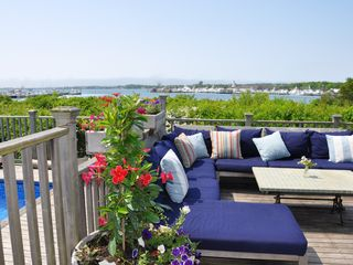 Montauk house photo - Best spot on the deck. That is the Montauk Yacht club across the lake.