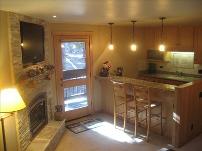 Open concept kitchen and living area with deck and BBQ just steps away.