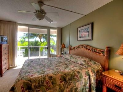 Beautiful bedroom with new furniture, Cal King bed, ceiling fan, new A/C & view.