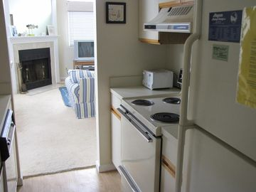 Kitchen has easy access to family living area. Toaster, microwave.