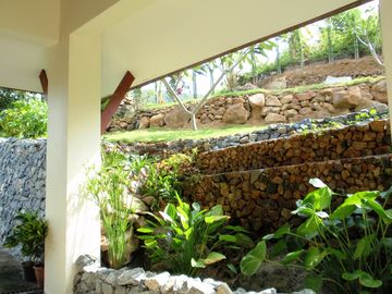 Waterfall by the main entrance porch