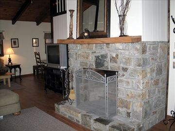 Living Room with Stone Wood Burning Fireplace