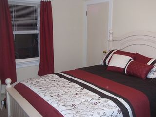 Seabrook apartment photo - Luxurious queen bed, freshly painted, clean, comfortable bedroom. Apt 1