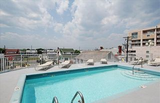 Oceans Mist Ocean City condo photo - Sit and relax by the pool just steps away from the condo.