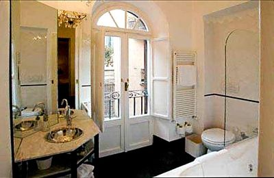 Beautiful second bathroom has a small balcony.